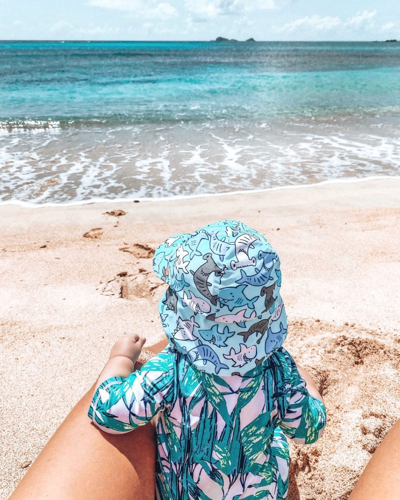 Summer Baby Beach Essentials - Cover up with a rash guard swimsuit and hat